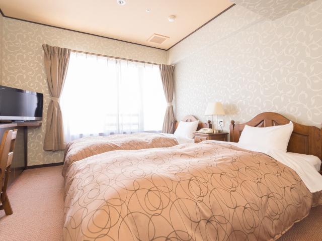 客室一例 里山 和洋室タイプ ベッドルーム